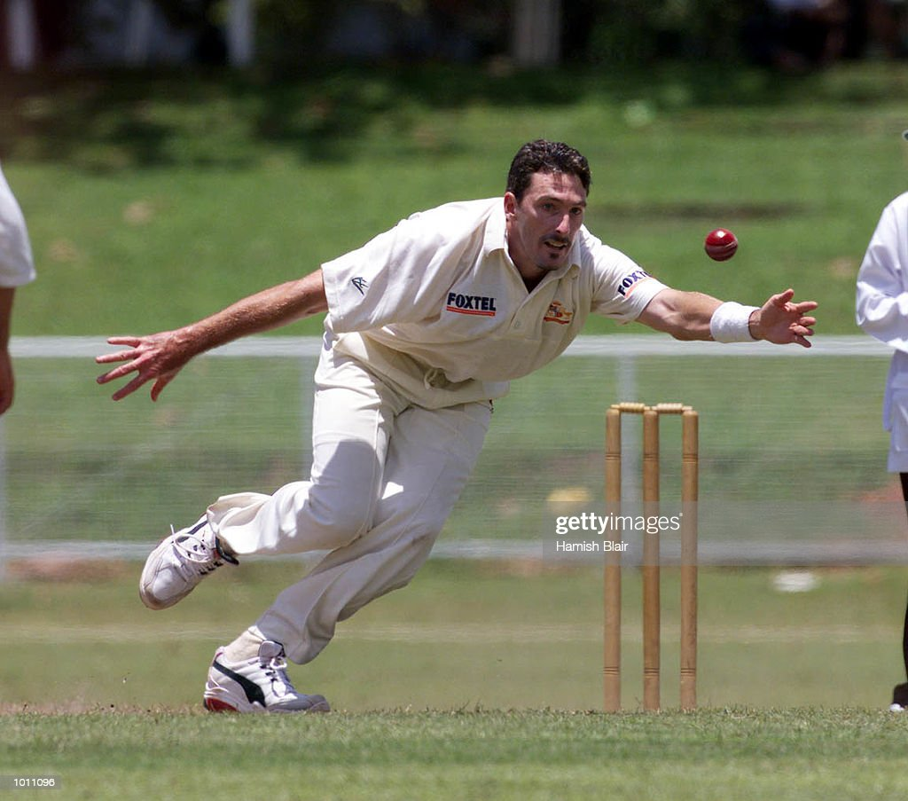 Damien Fleming of Australia lunges to field off his own bowling, during day three of the Tour match between the Sri Lanka Board XI and Australia at Colombo Cricket Club, Colombo, Sri Lanka.X Mandatory Credit: Hamish Blair/ALLSPORT