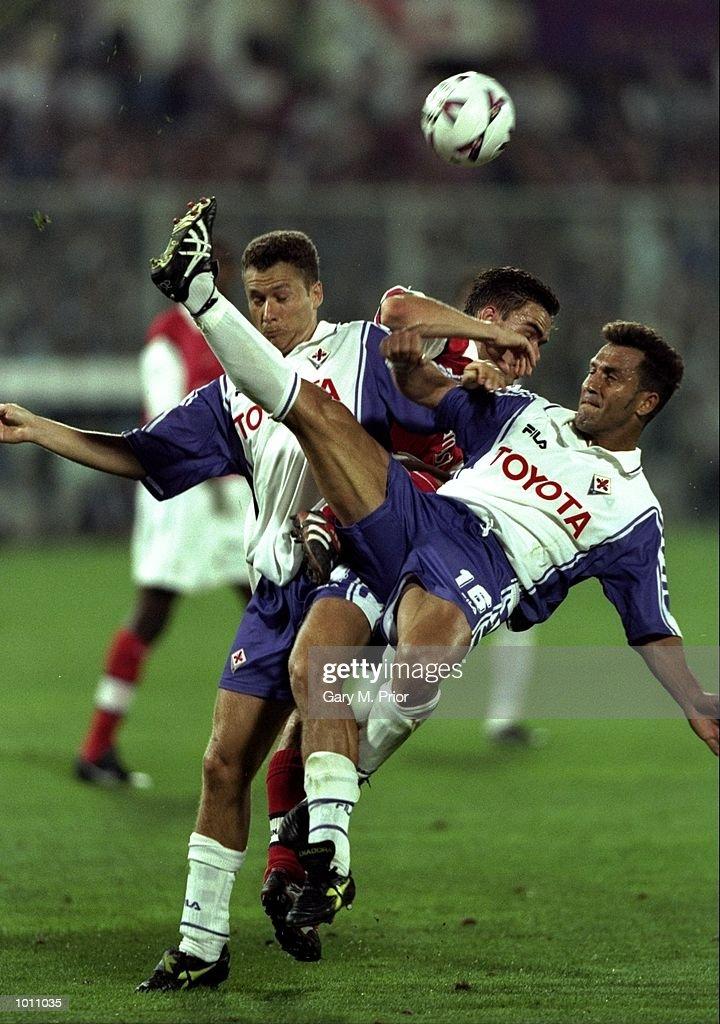 Daniele Adanji and Angelo Di Livio of Fiorentina foil Marc Overmars of Arsenal during the UEFA Champions League group B match at the Stadio Communale in Florence, Italy. The game ended goalless. \ Mandatory Credit: Gary M Prior/Allsport