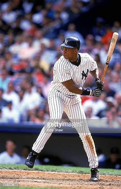 Darryl Strawberry of the New York Yankees steps into the swing during a game against the Oakland Athletics at Yankee Stadium in Bronx New York The...