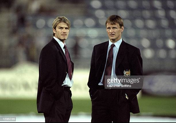 David Beckham and Teddy Sheringham of Manchester United inspect the pitch and take in the atmosphere prior to the UEFA Champions League match between...