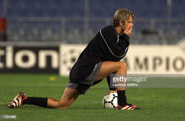 David Beckham of Manchester United ponders with the ball during the Manchester United training session at the Arnold Schwarzenegger Stadium at Graz...