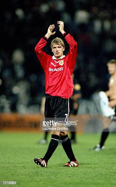 David Beckham of Manchester United salutes the crowd after the UEFA Champions League match against Sturm Graz at the Arnold Schwarzenegger Stadium in...