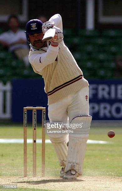 David Boon of Durham punches the ball up the ground for four during the County Championship game against Leicestershire at Grace Road Leicester...