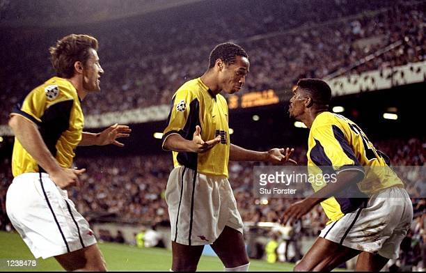 Davor Suker Thierry Henry and Nwankwo Kanu of Arsenal celebrate Kanu's 81st minute equaliser during the Barcelona v Arsenal UEFA Champions League...