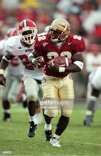 Davy Ford of the Florida State Seminoles carries the ball during the game against the North Carolina State Wolfpack at the Doke Campbell Stadium in...