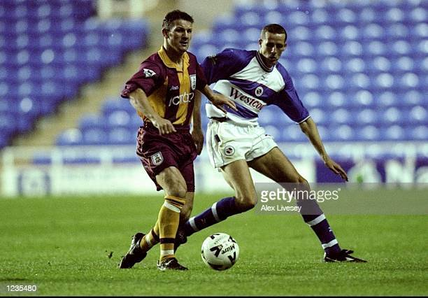 Dean Windass of Bradford and Barry Hunter of Reading in action during the Reading v Bradford City Worthington Cup Round 2 Leg 2 match played at the...
