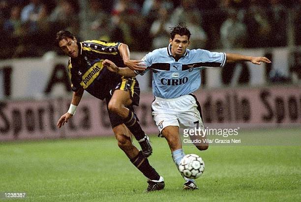 Diego Fuser of Parma battles with Sergio Conceicao of Lazio during the Serie A match between Parma and Lazio played at the Stadio Ennio Tardini Parma...