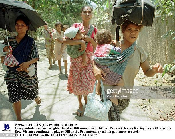 Sep 1999 Dili East Timor In A ProIndependence Neighborhood Of Dili Women And Children Flee Their Homes Fearing They Will Be Set On FireViolence...