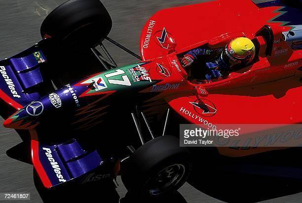 Driver Mauricio Gugelmin of Brazil drives the Mercedes Reynard 99I for Pacwest Racing sits in his car during the Molson Indy Vancouver part of the...