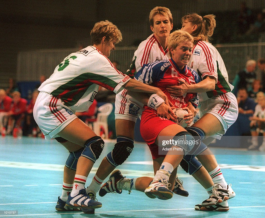 Else-Marthe Sorlie of Norway is held back by a strong Hungarian defence during the match between Norway and Hungary, at the Southern Cross International Handball Challenge, at the Buring Pavilion, Sydney Olympic Park Homebush, Sydney Australia. Mandatory Credit: Adam Pretty/ALLSPORT