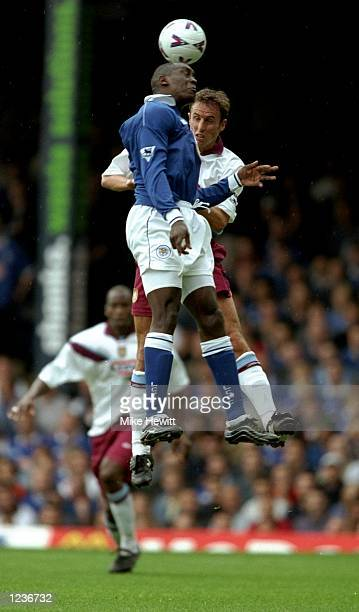 Emile Heskey of Leicester and Gareth Southgate of Aston Villa during the FA Carling Premiership match played at Filbert Street in Leicester England...