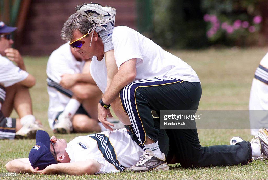 Errol Allcot, Australian Physio helps captain Steve Waugh stretch, during Australian training at Asgiriay Stadium, Kandy, Sri Lanka. Mandatory Credit: Hamish Blair/ALLSPORT