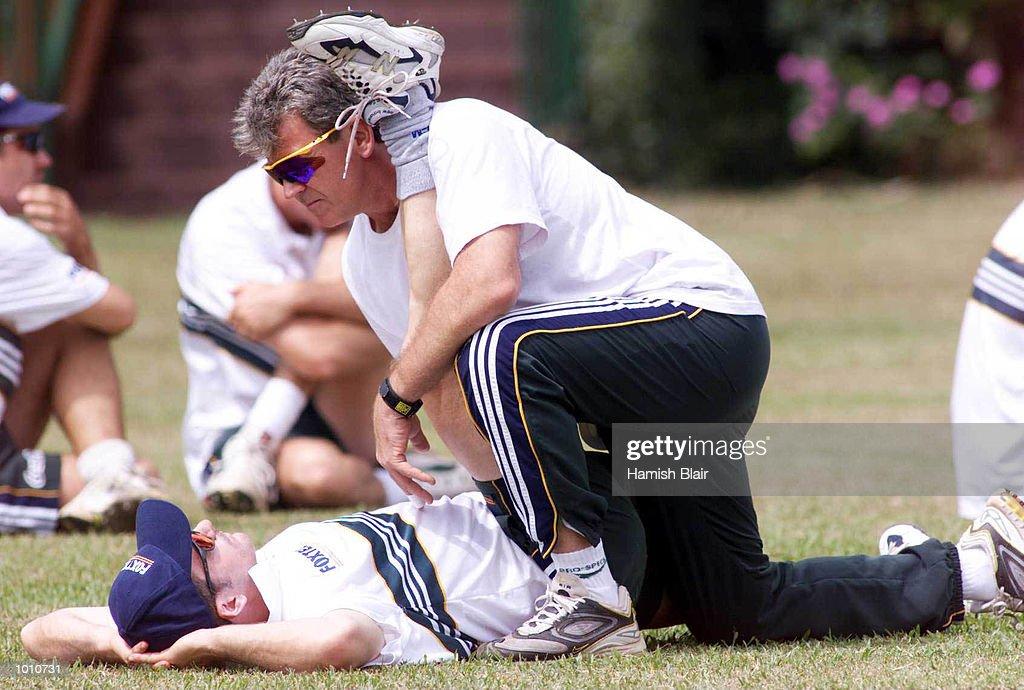 Errol Allcot, Australian Physio helps captain Steve Waugh stretch, during Australian training at Asgiriay Stadium, Kandy, Sri Lanka. Mandatory Credit: Hamish Blair/ALLSPORT