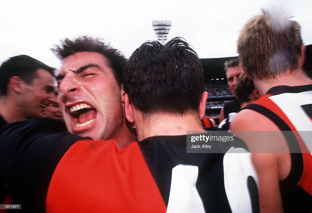 Essendon players celebrate after their, in the AFL Reserves Grand Final match between St Kilda and Essendon, played at the Melbourne Cricket Ground, Melbourne, Australia. Essendon defeated St Kilda. Mandatory Credit: Jack Atley/ALLSPORT