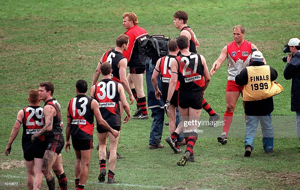 Essendon players line up to shake hands with Tony Lockett #4 for the Sydney Swans following the fourth qualifying final played at the Melbourne Cricket Ground, Melbourne, Australia between Essendon and Sydney. Lockett, who is the A.F.L. alltime leading goalkicker retired after the match. Essendon won the match easily. Mandatory Credit: Jack Atley/ALLSPORT