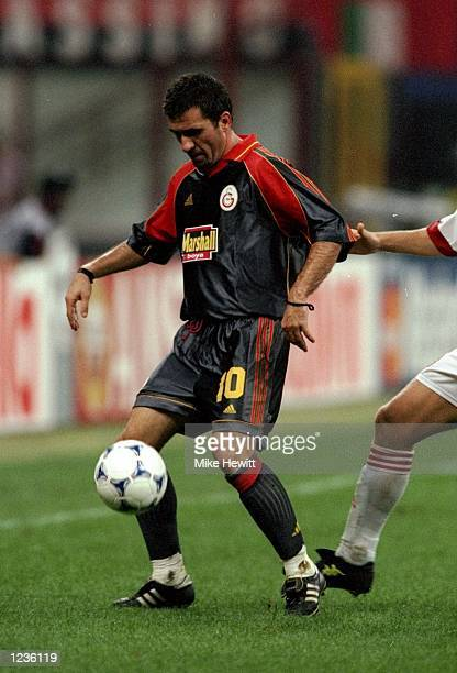 Gheorghe Hagi of Galatasaray on the ball against AC Milan during the Champions League match at the San Siro in Milan, Italy. Milan won 2-1. \...