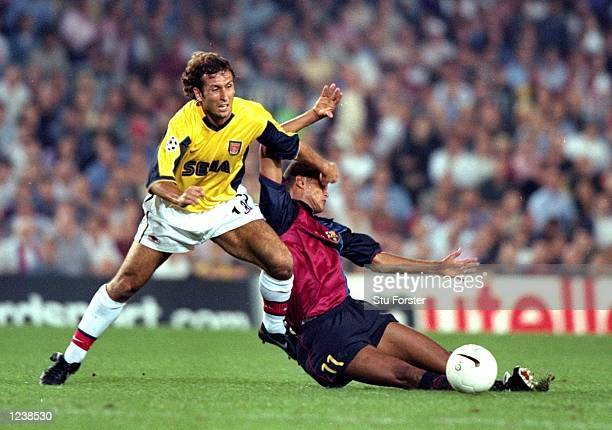 Gilles Grimandi of Arsenal fends off Barcelona's Rivaldo during the Barcelona v Arsenal UEFA Champions League Group B match played at the Nou Camp...