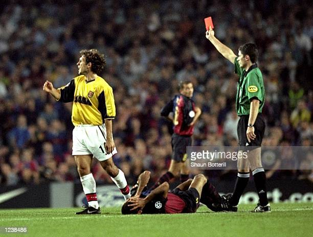 Gilles Grimandi of Arsenal is shown the red card during the Barcelona v Arsenal UEFA Champions League Group B match played at the Nou Camp Barcelona...