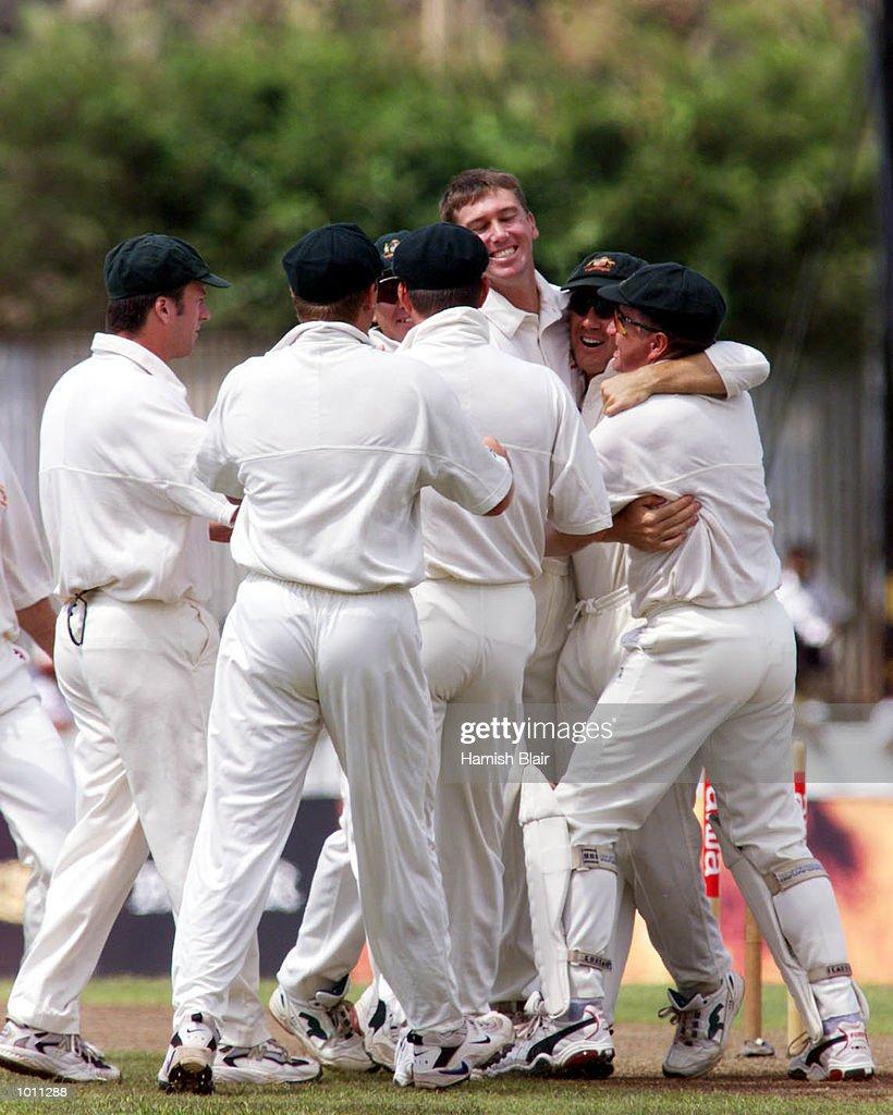 Glenn McGrath of Australia celebrates with team mates, after taking the wicket of Sanath Jayasuriya of Sri Lanka off the first ball of the game, during day one of the second test between Sri Lanka and Australia at Galle International Stadium, Galle, Sri Lanka.X Mandatory Credit: Hamish Blair/ALLSPORT
