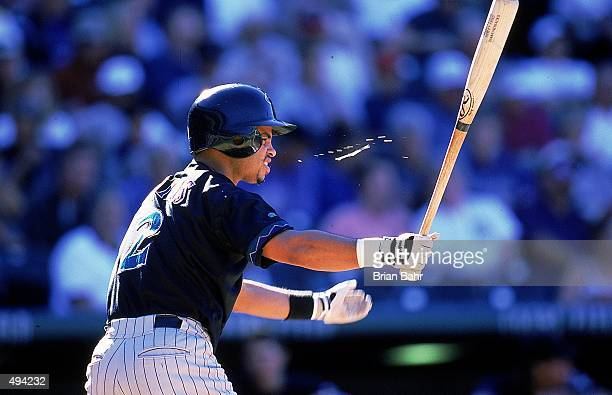 Hanley Frias of the Arizona Diamondbacks spits as he swings his bat during the game against the Colorado Rockies at Coors Field in Denver Colorado...