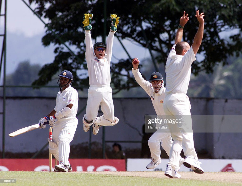Ian Healy (in air), Justin Langer (with ball) and Colin Miller of Australia, celebrate as Langer catches Maravan Attapatu of Sri Lanka, during day two of the First Test between Sri Lanka and Australia at Asgiriya Stadium, Kandy, Sri Lanka.Mandatory Credit: Hamish Blair/ALLSPORT