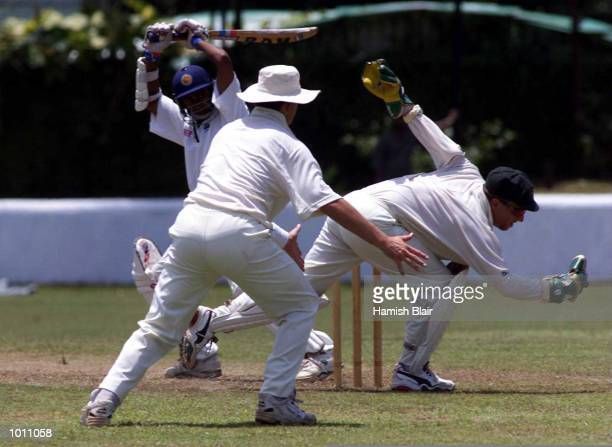 Ian Healy of Australia dives for a ball with Mark Waugh of Australia and batsmen Nimish Perera of the Board XI looking on during two of the Tour...