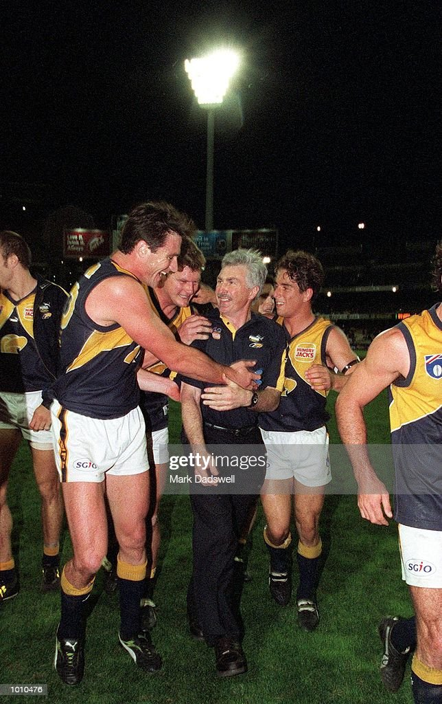 Jason Ball #26, Scott Cummings #14 and Phillip Read #36 for the West Coast Eagles celebrate their win with coach Mick Malthouse after the fist Qualifying Final played between the Western Bulldogs and the West Coast Eagles played at the M.C.G, Melbourne, Australia. West Coast won the match by five points. Mandatory Credit: Mark Dadswell/ALLSPORT