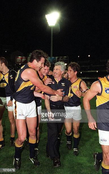 Jason Ball Scott Cummings and Phillip Read for the West Coast Eagles celebrate their win with coach Mick Malthouse after the fist Qualifying Final...