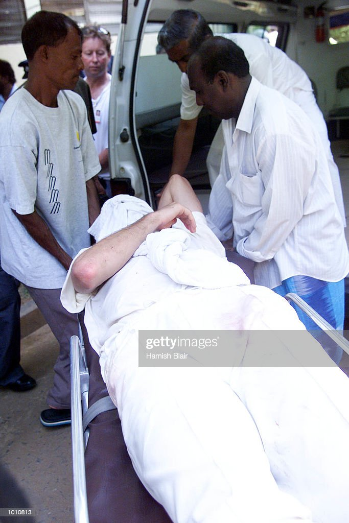 Jason Gillespie leaves for hospital after he and Steve Waugh of Australia collided attempting a catch, during day two of the First Test between Sri Lanka and Australia at Asgiriya Stadium, Kandy, Sri Lanka. Mandatory Credit: Hamish Blair/ALLSPORT