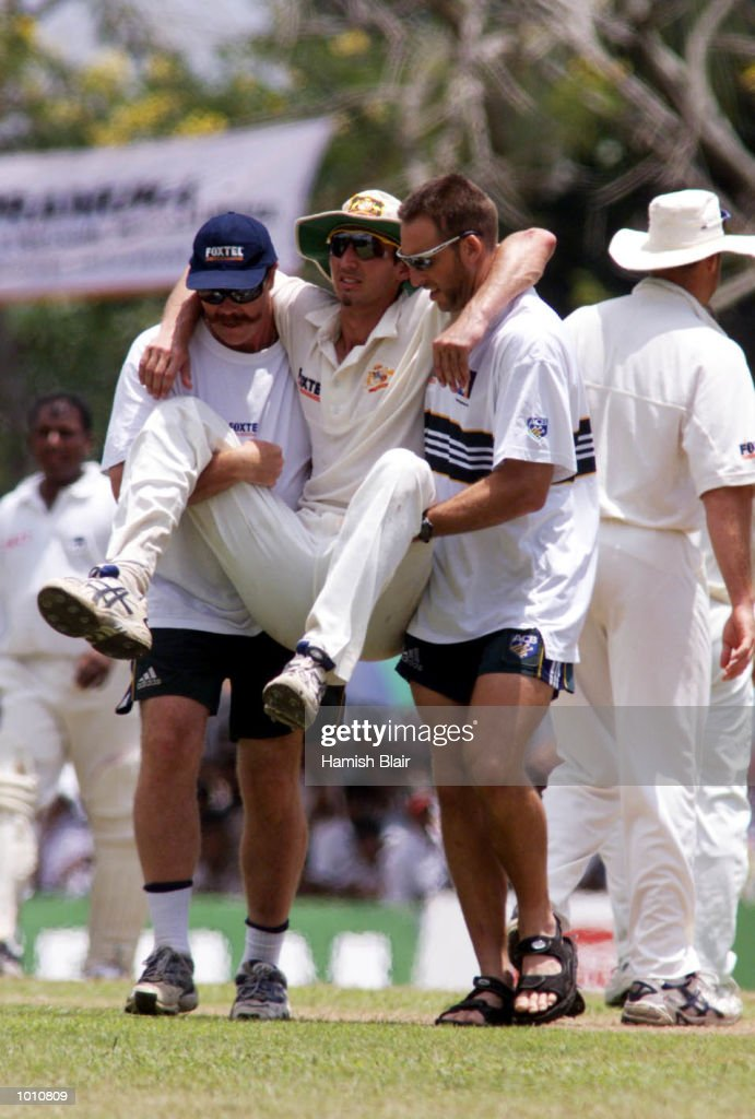 Jason Gillespie leaves the field with assistance from sercurity manager Reg Dickason and fitness manager Dave Misson after he and Steve Waugh of Australia collided attempting a catch, during day two of the First Test between Sri Lanka and Australia at Asgiriya Stadium, Kandy, Sri Lanka. Mandatory Credit: Hamish Blair/ALLSPORT