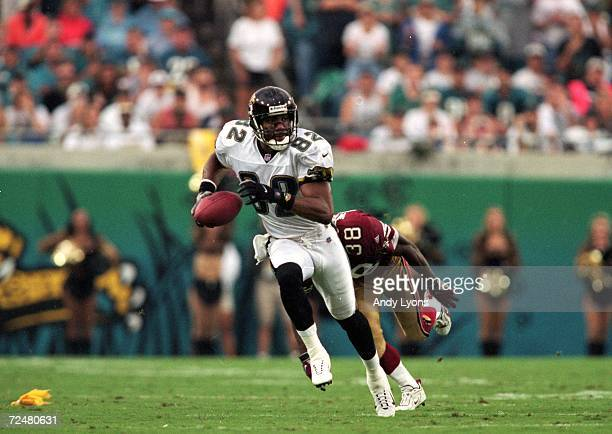 Jimmy Smith of the Jacksonville Jaguars runs with the ball away from Darnell Walker of the San Francisco 49ers during the game at the Alltell Stadium...