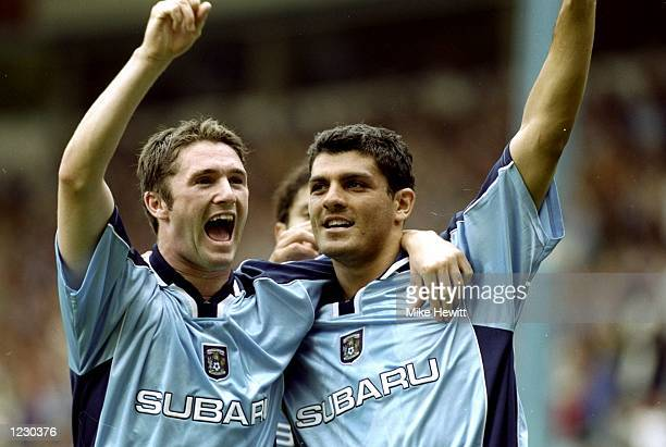 John Aloisi of Coventry City celebrates his goal with team mate Robbie Keane during the FA Carling Premiership match against Leeds United at...