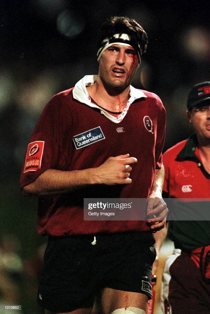John Eales of the Queensland Reds runs off to receive treatment for a head wound against the NSW Waratahs during the National Ricoh Championship game at Ballymore, Brisbane, Australia. Mandatory Credit: Allsport Aus/ALLSPORT