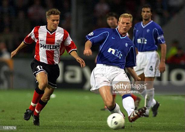 Jorg Albertz of Rangers battles for the ball with Joonas Kolkka of PSV in the Champions League match between PSV Eindhoven and Glasgow Rangers at the...