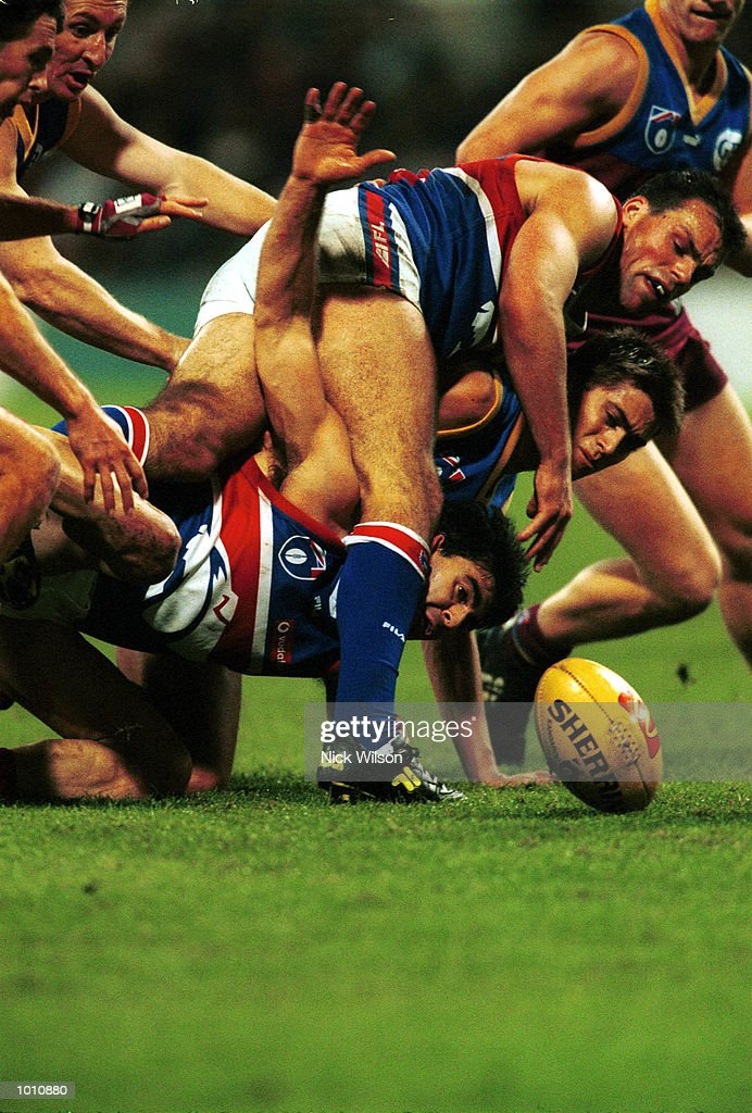 Jose Romero #36 of Western Bulldogs ,Alastair Lynch #11 of Brisbane and Paul Dimattina of Western Bulldogs competer for the ball during the 2nd semi final between the Brisbane Lions and the Western Bulldogs at the Gabba, Brisbane, Australia. Mandatory Credit: Nick Wilson/ALLSPORT
