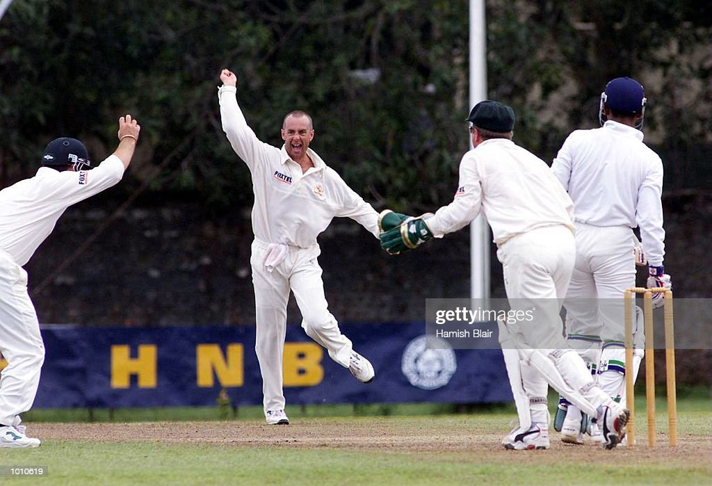 Justin Langer (left) of Australia claims a catch off Prasanna Jaywardene of the Board XI as bowler Colin Miller and wicketkeeper Ian Healy start to celebrate, however the catch was controversially given not out, during day two of the match between the Sri Lanka Board XI and Australia at Saravanamuttu Stadium, Colombo, Sri Lanka. Mandatory Credit: Hamish Blair/ALLSPORT