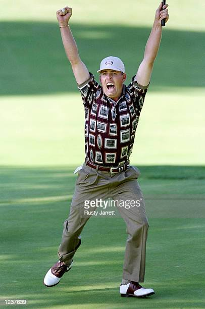 Justin Leonard of the USA celebrates holing a long birdie putt on the 17th green during the final day of the 33rd Ryder Cup at Brookline Country...