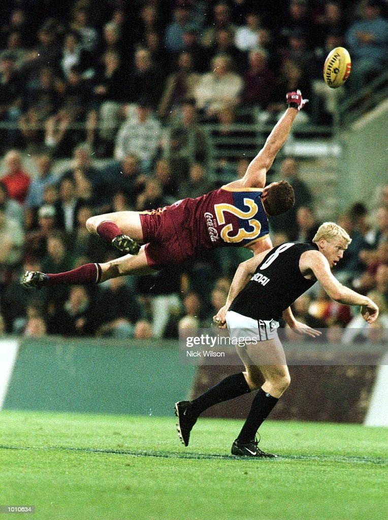 Justin Leppitsch #23 of the Brisbane Lions on the left attempts a mark whilst under pressure from Lance Whitnall #8 of Carlton during the second AFL qualifying final at The Gabba, Brisbane, Australia. Mandatory Credit: Nick Wilson/ALLSPORT