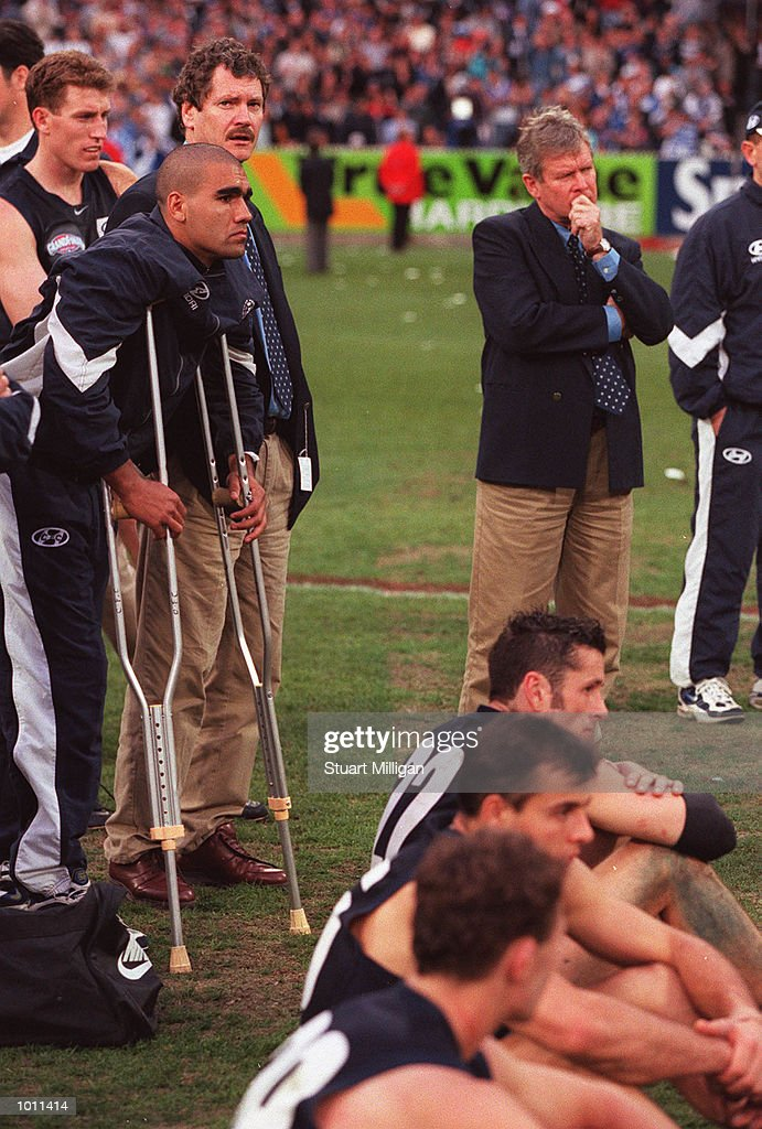 Justin Murphy #18 (on crutches) for Carlton and Colin Kinnear, Carlton Football Manager contemplate Carlton's loss, in the AFL Grand Final match between the Kangaroos and Carlton, played at the Melbourne Cricket Ground, Melbourne, Australia. The Kangaroos defeated Carlton. Mandatory Credit: Stuart Milligan/ALLSPORT