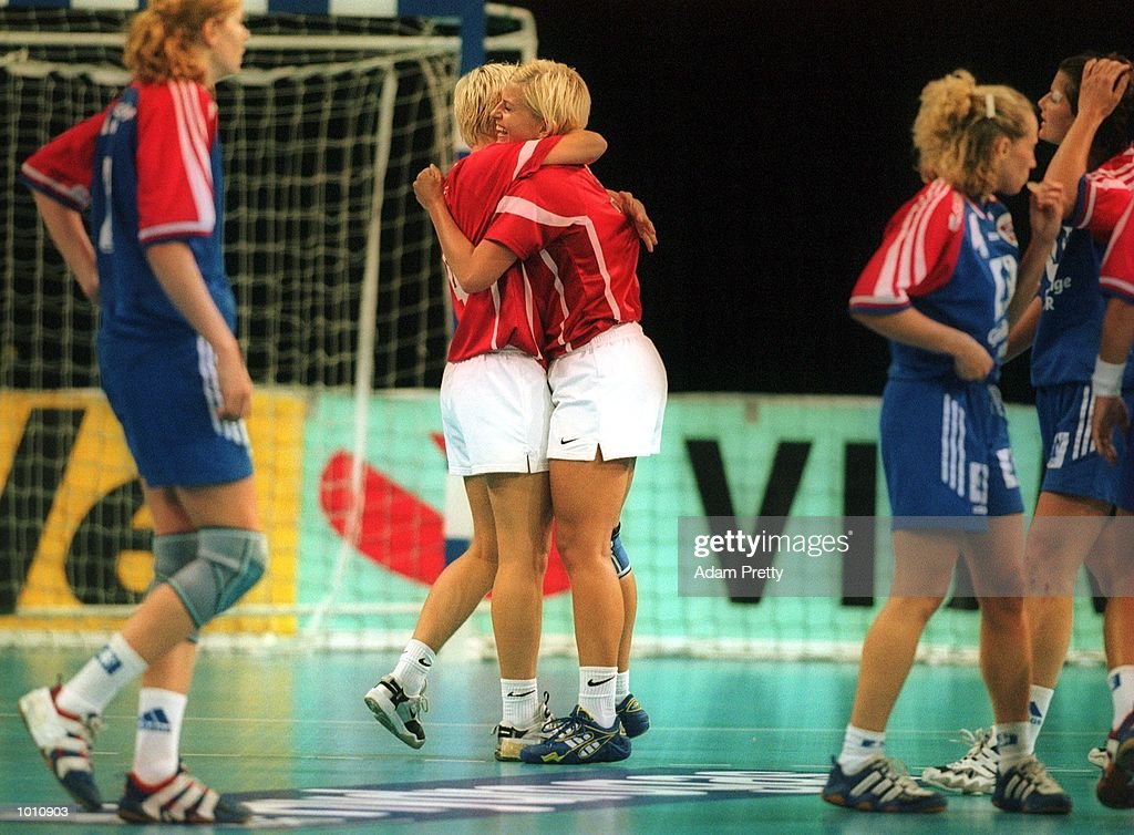 K. Anderson of Denmark celebrates with a teammate after winning the gold medal game vs Norway, at the Southern Cross International Handball Challenge, a SOCOG Olympic test event, Buring Pavilion, Olympic Park Homebush Sydney Australia. Mandatory Credit: Adam Pretty/ALLSPORT