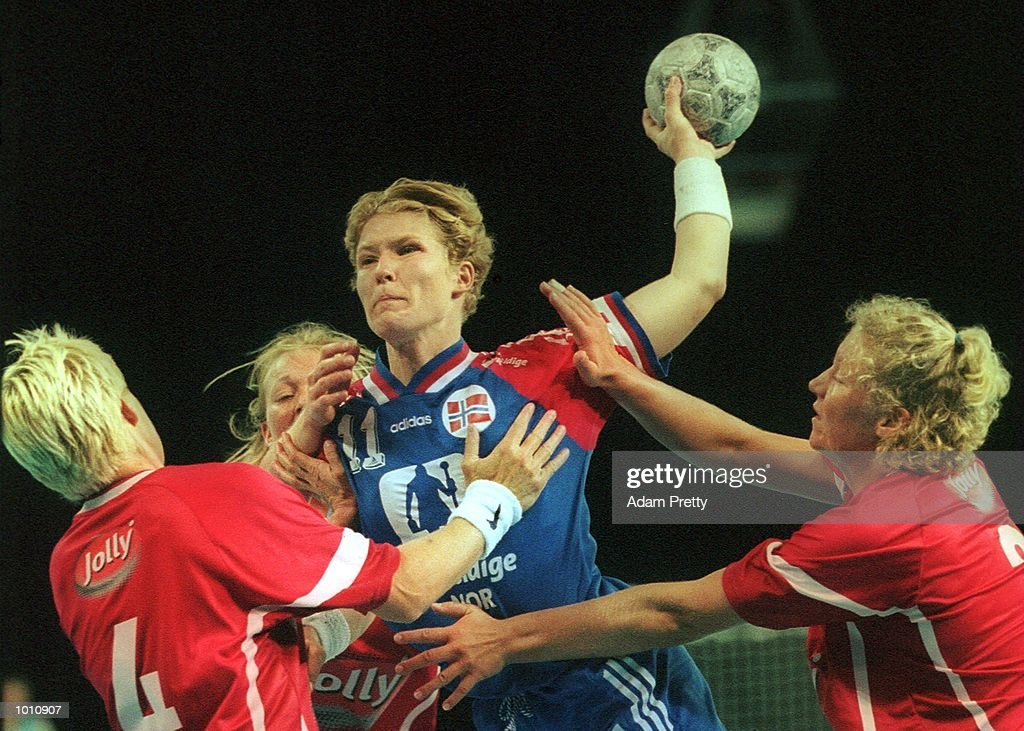 K. Duvholt of Norway is wrestled by strong Denmark defence during thr gold medal game. Denmark won the game, at the Southern Cross International Handball Challenge, a SOCOG Olympic test event, Buring Pavilion, Olympic Park Homebush Sydney Australia. Mandatory Credit: Adam Pretty/ALLSPORT