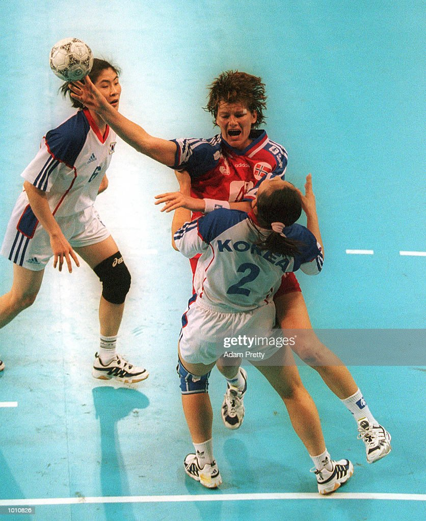 10 Sep 1999. K. Grini of Norway clashes with H. Kwag of Korea, during Norways win of 26 to 25 over Korea at the Southern Cross International Handball Challenge, a SOCOG Olympic test event, Buring Pavilion, Olympic Park Homebush Sydney Australia. Mandatory Credit: Adam Pretty/ALLSPORT