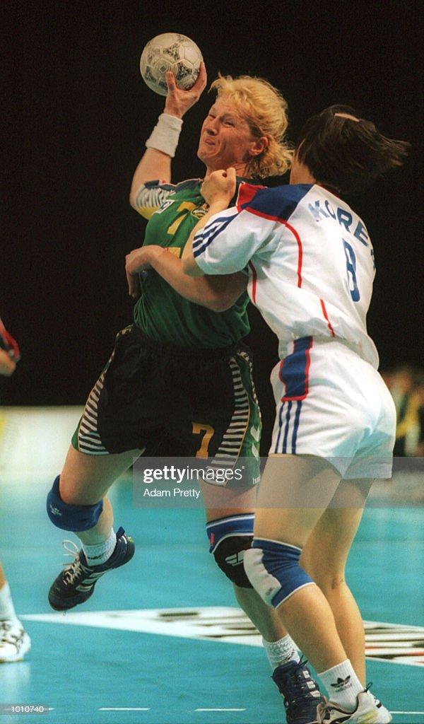 Katrina Shinfeld of Australia is held back by Hyun-Ok Kim of Korea during the Korea vs Australia match, at the Southern Cross International Handball Challenge, at the Buring Pavilion, Sydney Olympic Park Homebush, Sydney Australia. Mandatory Credit: Adam Pretty/ALLSPORT