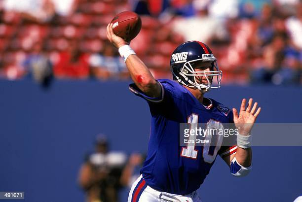 Kent Graham of the New York Giants gets ready to pass the ball during the game against the Washington Redskins at the Giants Stadium in East...