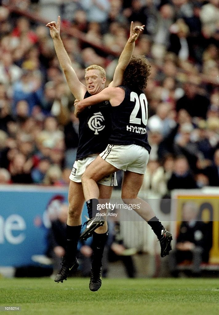 Lance Whitnall and Fraser Brown #20 of the Carlton Blues celebrate victory following the AFL Second Preliminary Final against the Essendon Bombers at the MCG in Melbourne, Australia. Carlton progressed to the Grand Final with a tense 104 -103 win. \ Mandatory Credit: Jack Atley /Allsport