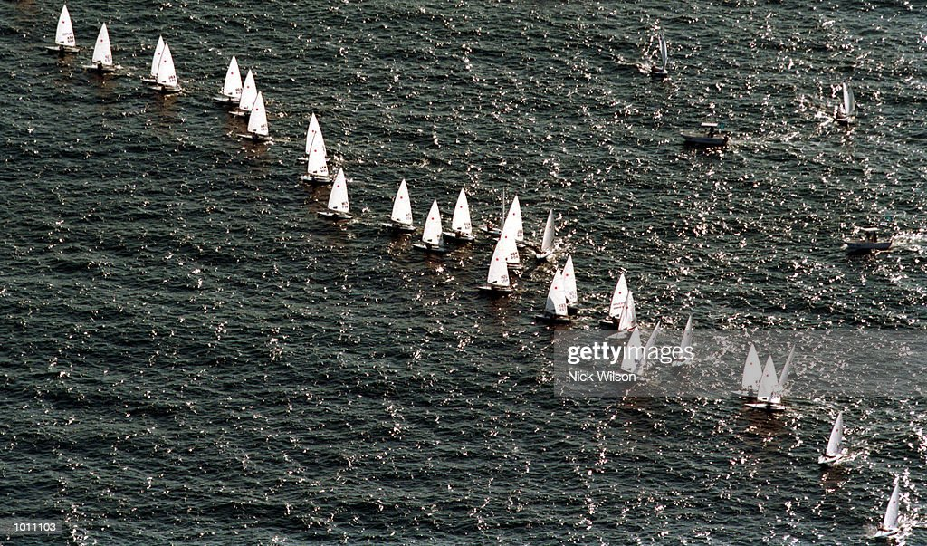 Laser class make their way across the harbour during the 1999 Sydney Harbour Regatta in Sydney Harbour, Sydney, Australia. Mandatory Credit: Nick Wilson/ALLSPORT