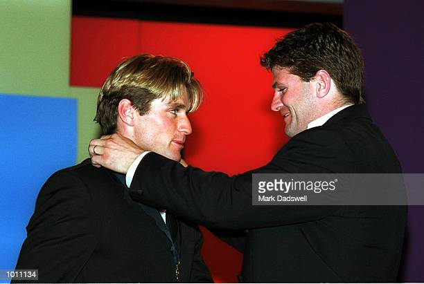 Last years Brownlow medal winner Robert Harvey of St Kilda hands Shane Crawford of Hawthorn the brownlow medal after winning the prestigious award at...