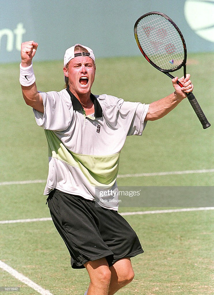 Lleyton Hewitt of Australia celebrates winning his singles match against Marat Safin of Russia 7-6, 6-2, 4-6, 6-3 during the Davis Cup semi final at the ANZ Stadium, Brisbane, Australia. Mandatory Credit: Nick Wilson/ALLSPORT