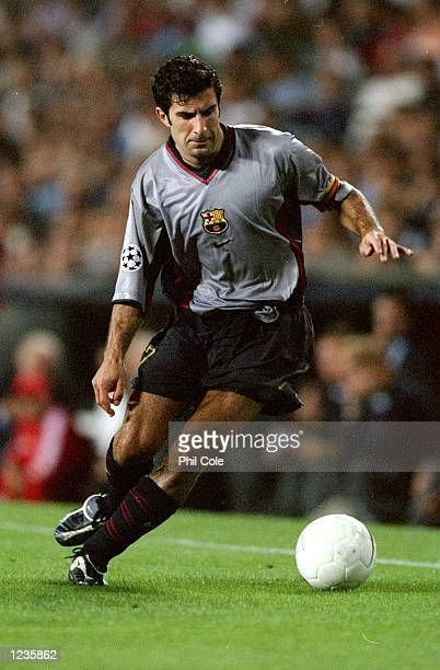 Luis Figo of Barcelona in action against Fiorentina during the UEFA Champions League group B match at the Nou Camp in Barcelona Spain Barcelona won...