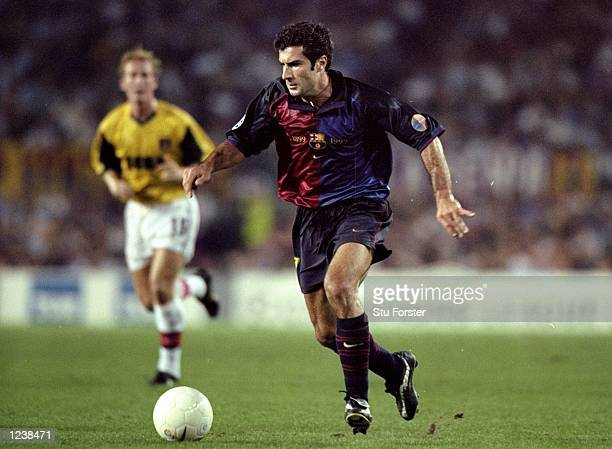 Luis Figo of Barcelona in action during the Barcelona v Arsenal UEFA Champions League Group B match played at the Nou Camp Barcelona Spain The game...
